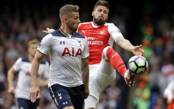 FILE - This is a  Sunday, April 30, 2017 file photo of Tottenham Hotspur's Toby Alderweireld, left, battles for the ball with Arsenal's Olivier Giroud during the  north London derby match in English Premier League soccer match between the two teams in north London. Tottenham is heading into a north London derby on Saturday Nov. 18, against Arsenal as a clear favorite for the first time in decades. Tottenham is three places ahead of Arsenal this season and finished above its neighbor last season in the Premier League for the first time since Arsene Wenger took charge of Arsenal in 1996.  (AP Photo/Alastair Grant/File)