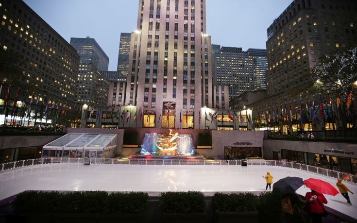 People watch attendants skate past the statue of Prometheus at the ice rink at Rockefeller Center in New York Wednesday, Oct. 11, 2017, in New York. (AP Photo/Frank Franklin II)