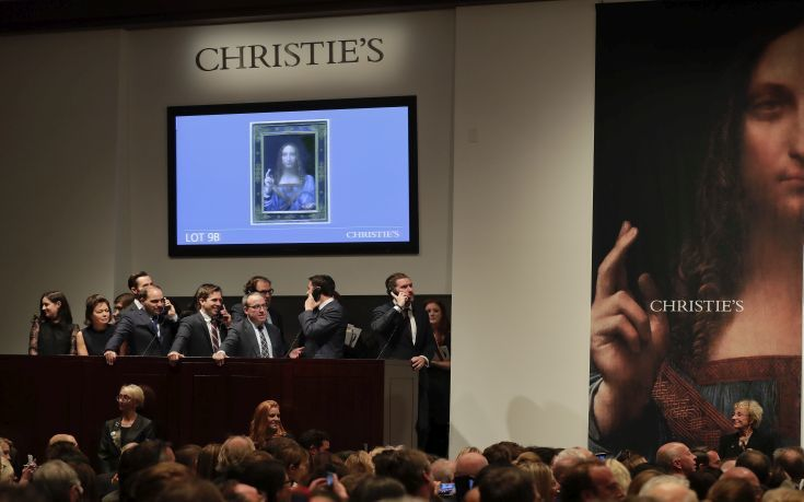 """CORRECTS PRICE - Bidding representatives wait on phones for instructions from bidders for Leonardo da Vinci's """"Salvator Mundi"""" at Christie's, Wednesday, Nov. 15, 2017, in New York. The painting sold for $450 million. (AP Photo/Julie Jacobson)"""