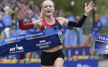 Shalane Flanagan of the United States crosses the finish line first in the women's division of the New York City Marathon in New York, Sunday, Nov. 5, 2017. (AP Photo/Seth Wenig)
