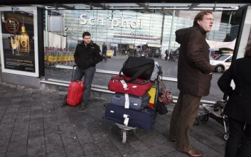 Passengers are seen outside Schiphol airport in Amsterdam, Netherlands on Saturday Dec. 26, 2009. A Northwest Airlines passenger from Nigeria who claimed to be acting on orders from al-Qaida set off an explosive device on a Christmas Day flight in a failed terrorist attack on the plane as it was landing in Detroit, US Federal officials said. The suspect boarded in Nigeria and went through Schiphol airport in Amsterdam en route to Detroit. Dutch anti-terrorism authorities said the U.S. has asked all airlines to take extra precautions on flights worldwide that are bound for the United States. (AP Photo/Evert Elzinga)