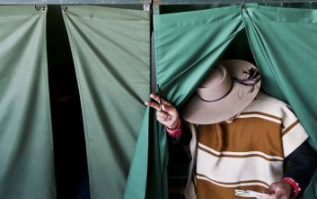 A man in traditional costume as 'Huaso' leaves a voting booth after casting his vote during presidential elections in Santiago, Chile, Sunday, Nov. 19, 2017. (AP Photo/Esteban Felix)