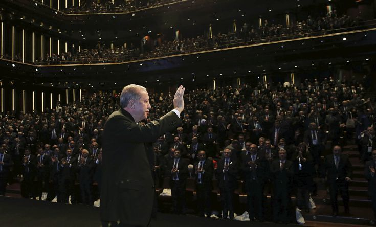 Turkey's President Recep Tayyip Erdogan acknowledges the audience as he arrives to deliver a speech at a tourism council in Ankara, Turkey, Wednesday, Nov. 1, 2017. (Pool Photo via AP)