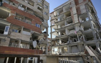 Buildings are damaged by an earthquake in a compound which was built under the Mehr state-owned program, in Sarpol-e-Zahab in western Iran, Tuesday, Nov. 14, 2017. Iran's President Hassan Rouhani says his administration will probe the cause of so much damage to buildings constructed under the Mehr program after a powerful earthquake hit the area along the border with Iraq on Sunday which killed over 400 people. (AP Photo/Vahid Salemi)