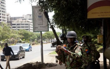 A police officer loads his gun to fire tear gas on Uhuru Highway, Nairobi, Kenya, Friday, Nov.17, 2017.  Kenyan police have used tear gas and water cannons to disperse supporters of political opposition leader Raila Odinga, who are trying to gather near the country's main airport and Uhuru park to welcome him back from an overseas trip.  (AP Photo/Sayyid Abdul Azim)