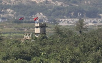 A North Korean flag flutters in the wind at North Korean military guard post, seen from the truce village of Panmunjom in the Demilitarized Zone during a media tour in Paju, South Korea, Thursday, Sept. 28, 2017. (AP Photo/Lee Jin-man)