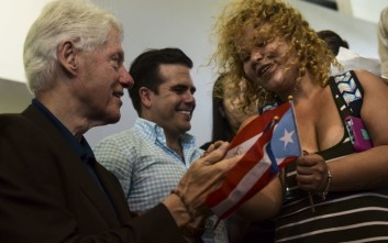 Former President Bill Clinton visits residents at the William Rivera Betancourt Vocational School which was turned into an emergency shelter for families affected by the impact of Hurricane Maria, in Canovanas, Puerto Rico, Monday, Nov. 20, 2017.  (AP Photo/Carlos Giusti)