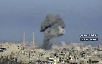 "In this Sunday, Jan. 30, 2017 frame grab from video provided by the government-controlled Syrian Central Military Media, black smoke rises from an airstrike on an Islamic State group's position, in Deir al-Zour, north Syria. The World Food Program said Tuesday that it has resumed food airdrops to Deir al-Zour, in eastern Syria, after the Islamic State group renewed its assault on the city two weeks ago. Rebels, al-Qaida linked insurgents, IS militants, and government forces and loyal militias are all skirmishing for control of Syria's southern provinces. Arabic reads, ""Central Military Media, Deir al-Zour, Syria."" (Syrian Central Military Media, via AP)"