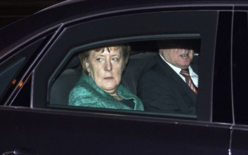 Chairwoman of the Christian Democratic Union and German Chancellor Angela Merkel and Bavaria's Prime Minister Horst Seehofer of Christian Social Union, arrive for a meeting with German President Frank-Walter Steinmeier at Bellevue Palace in Berlin, Germany, Thursday Nov. 30, 2017.  The meeting is part of a series aimed at forming a coalition government, to eliminate the need for new general elections. (Bernd von Jutrczenka/dpa via AP)