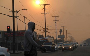 Smoke fills the sky near Hansen Dam in San Fernando Valley as a wildfire burns in the area in Los Angeles on Tuesday Dec. 5, 2017. Ferocious Santa Ana winds raking Southern California whipped explosive wildfires Tuesday, prompting evacuation orders for thousands of homes. (AP Photo/Richard Vogel)