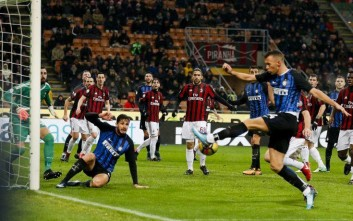 Inter Milan's Ivan Perisic, right, kicks the ball to score a goal that was later disallowed because of his teammate Andrea Ranocchia's off-side (second from left) during an Italian Cup quarter-final soccer match between Milan and Inter Milan at the San Siro stadium in Milan, Italy, Wednesday, Dec. 27, 2017. (AP Photo/Antonio Calanni)