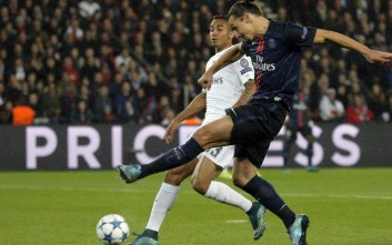PSG's Zlatan Ibrahimovic, right, kicks the ball ahead of Real Madrid's Danilo during the Champions League group A soccer match between Paris St Germain and Real Madrid at the Parc des Princes stadium in Paris, Wednesday, Oct. 21, 2015. (AP Photo/Thibault Camus)