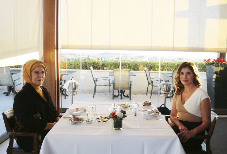 Betty Baziana, right, partner of Greece's Prime Minister Alexis Tsipras, meets with Emine Erdogan, wife of Turkey's President Recep Tayyip Erdogan, in Athens, Thursday, Dec. 7, 2017. Erdogan is in Greece on a two-day official visit. (Pool via AP)