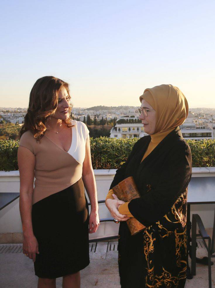 Betty Baziana, left, partner of Greece's Prime Minister Alexis Tsipras, talks with Emine Erdogan, wife of Turkey's President Recep Tayyip Erdogan, in Athens, Thursday, Dec. 7, 2017. Erdogan is in Greece on a two-day official visit. (Pool via AP)