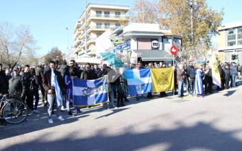 Έψαλαν τον εθνικό ύμνο ενάντια στην επίσκεψη Ερντογάν