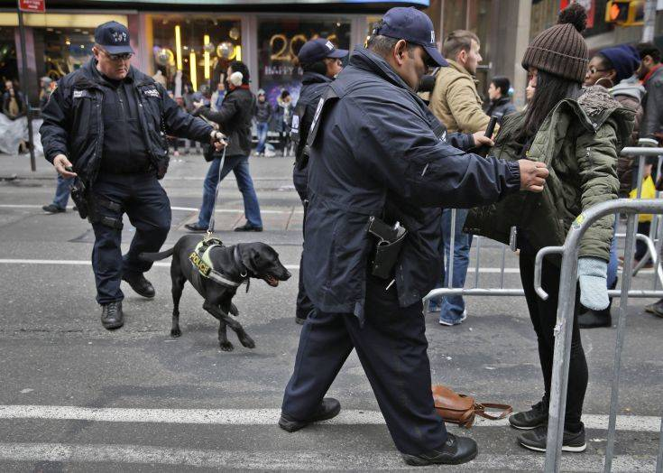 FILE - In this Dec. 31, 2015 file photo, pedestrians submit to a search as they enter Times Square in New York. New York Police Department officials say that while there are no specific or credible threats against the city, they are promising a bigger security detail than ever before at the Sunday, Dec. 31, 2017, New Year's Eve celebration in Times Square. (AP Photo/Seth Wenig, File)