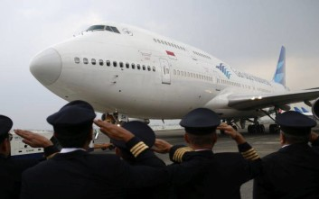 Garuda Indonesia pilots salute during the farewell ceremony for the airline's last Boeing 747 at Soekarno-Hatta International Airport in Tangerang, Indonesia, Monday, Oct. 9, 2017. The country's flag carrier on Monday retired its last serving jumbo jet after decades of service. (AP Photo/Dita Alangkara)