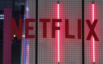 The logo of American entertainment company Netflix is pictured at the Paris games week in Paris, Saturday, Nov. 4, 2017. (AP Photo/Christophe Ena)
