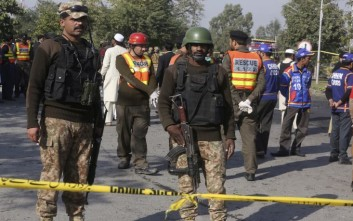 Pakistani army personnel cordon off the area of suicide attack in Peshawar, Pakistan, Friday, Nov. 24, 2017. A suicide bomber struck a vehicle carrying the deputy provincial police chief, killing him and his guard and wounding numerous others, police said. (AP Photo/Muhammad Sajjad)