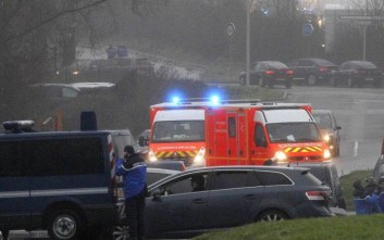 Ambulances try to make their way to Dammartin-en-Goele, northeast Paris, as part of an operation to seize two heavily armed suspects, Friday, Jan. 9, 2015. French security forces swarmed a small industrial town northeast of Paris Friday in an operation to capture a pair of heavily armed suspects in the deadly storming of a satirical newspaper. Shots were fired as the brothers stole a car in the early morning hours, said a French security official, who could not immediately confirm reports of hostages taken or deaths later in the day in the town of Dammartin-en-Goele, about 40 kilometers (25 miles) northeast of Paris. (AP Photo/Michel Spingler)