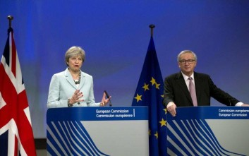 British Prime Minister Theresa May, left, an European Commission President Jean-Claude Juncker address a media conference at EU headquarters in Brussels on Friday, Dec. 8, 2017. British Prime Minister Theresa May, met with European Commission President Jean-Claude Juncker early Friday morning following crucial overnight talks on the issue of the Irish border.(AP Photo/Virginia Mayo)