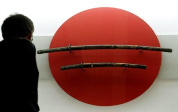 "A visitor admires a samurai's swords at the exhibition ""Japan - Traditions between Times and Worlds"" at the Museum of Ethnology"" in Luebeck, northern Germany, on Thursday, July 21, 2005. The show on display in connection with the current Schleswig-Holstein Music Festival focusing Japan features the historical and modern Japan. The show ends on December 30. (AP Photo/Heribert Proepper)"