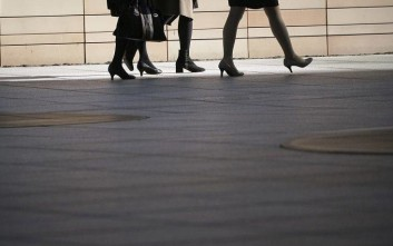 Women walk on a shopping street in Tokyo Friday, Nov. 17, 2017. Japan's economy expanded at a 1.4 percent annualized rate in July-September in the seventh straight quarter of growth for the world's third-largest economy. (AP Photo/Eugene Hoshiko)
