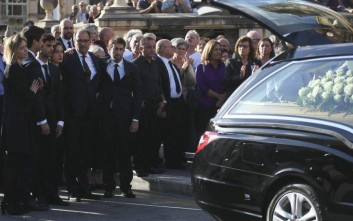Relatives and friend pay their last homage to the coffin of  investigative journalist Daphne Caruana Galizia after the funeral service in Valletta, Malta, Friday, Nov. 3, 2017.  Archbishop Charles Scicluna celebrated Daphne Caruana Galizia's funeral Mass in the church nearest to where the 53-year-old Malta native lived before the bomb exploded as she drove away from home on Oct. 16. Mourners included her husband, three adult sons and European Parliament President Antonio Tajani, while top Maltese government and opposition figures stayed away in deference to the wishes of Caruana Galizia's family. (AP Photo/Jonathan Borg)