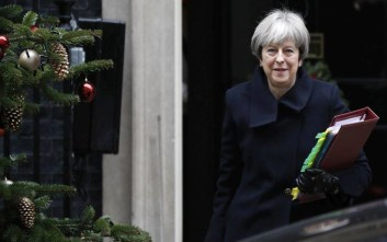 Britain's Prime Minister Theresa May leaves 10 Downing Street to attend the weekly session of Prime Ministers Questions in Parliament in London, Wednesday, Dec. 6, 2017. (AP Photo/Kirsty Wigglesworth)