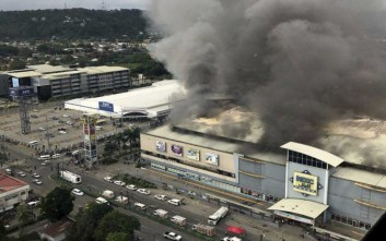 In this photo provided by Special Assistant to the President Christopher Bong Go, a fire rages at  shopping mall in Davao city, the hometown of Philippine President Rodrigo Duterte, on Saturday, Dec. 23, 2017 in southern Philippines. The fire which still raging for hours now have trapped an undetermined number of people, fire officials said. (AP Photo/Christopher Bong Go, Special Assistant to the President)