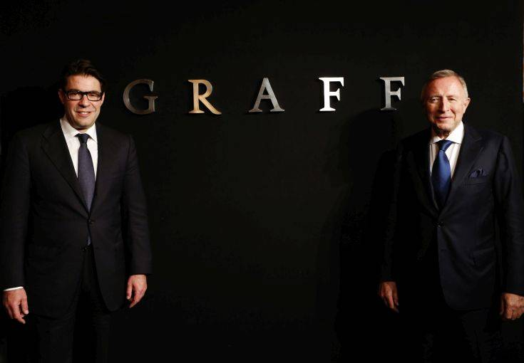FILE - In this Monday, May 21, 2012 file photo, Graff Diamonds Founder and Chairman Laurence Graff, right, and CEO Francois Graff stands before attending an IPO roadshow in Hong Kong. The London jeweler said Thursday, May 31, 2012 in a brief statement that it's postponing plans to go public in the southern Chinese financial center because of the recent downturn in global financial markets. Graff Diamonds would have been the latest in a line of foreign luxury brands to sell shares in Hong Kong. (AP Photo/Vincent Yu, File)