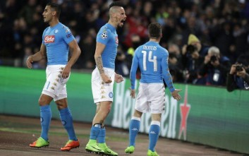 Napoli's Marek Hamsik, center, celebrates after Dries Mertens, right,scored the opening goal during the Champions League round of 16, second leg, soccer match between Napoli and Real Madrid at the San Paolo stadium in Naples, Italy, Tuesday March 7, 2017. (AP Photo/Andrew Medichini)
