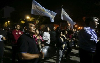 Protesters bang pots and wave Argentine flags against a pension reform, in front of the Congress in Buenos Aires, Argentina, Tuesday, Dec. 19, 2017. Argentina's Congress on Thursday approved a pension reform bill that has prompted violent protests and a general strike. (AP Photo/Victor R. Caivano)