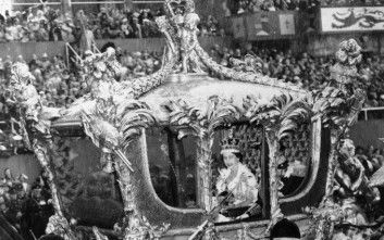The Queen Elizabeth II smiles to acknowledge the cheers of the crowd as her coach passes Hyde Park corner on the return journey from the Abbey in London, Feb. 6, 1953. (AP Photo)