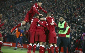 Liverpool players celebrate scoring their third goal during the English Premier League soccer match between Liverpool and Manchester City at Anfield Stadium, in Liverpool, England, Sunday Jan. 14, 2018. (AP Photo/Dave Thompson)