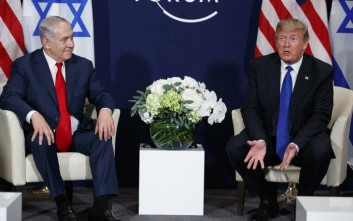 President Donald Trump speaks during a meeting with Israeli Prime Minister Benjamin Netanyahu at the World Economic Forum, Thursday, Jan. 25, 2018, in Davos. (AP Photo/Evan Vucci)