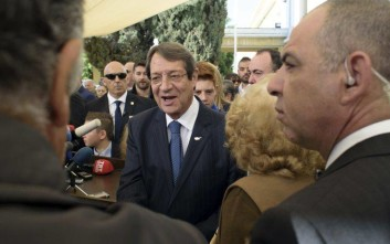 Cyprus' President and Cypriot Presidential candidate Nicos Anastasiades waves to the crowd outside a polling station during the presidential elections in the southern coastal city of Limassol, Cyprus, on Sunday, Jan. 28, 2018. Cypriots were voting Sunday for a new president who they hope will overcome years of failure and finally resolve the ethnic divisions that have torn the Mediterranean island-nation into a Greek south and a Turkish north. (AP Photo/Pavlos Vrionides)