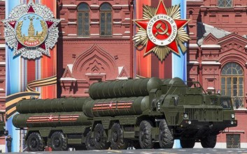 Russian the S-400 air defense missile systems drive during a rehearsal for the Victory Day military parade in Red Square in Moscow, Russia, Sunday, May 7, 2017. The parade will take place in Moscow's Red Square on May 9 to celebrate 72 years since the end of WWII and the defeat of Nazi Germany. (AP Photo/Alexander Zemlianichenko)