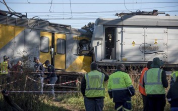 Emergency services and police work at the scene of a train crash near Johannesburg, Thursday, June 1, 2017. South African paramedics say a train driver was killed and 50 other people were injured in the collision at a station near Johannesburg. (AP Photo)