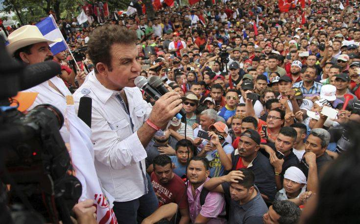 Opposition leader Salvador Nasralla speaks to supporters at a rally where he reaffirmed his claim on the presidency of Honduras, in the central park of San Pedro Sula, Honduras, Saturday, Jan. 6, 2018. Following a disputed election marred by irregularities, incumbent Juan Orlando Hernandez was declared the victor and will be inaugurated on Jan. 27. At a march and rally that drew thousands, Nasralla said he would not stop calling for protests and civil disobedience until Hernandez agrees to step down. (AP Photo/Fernando Antonio)