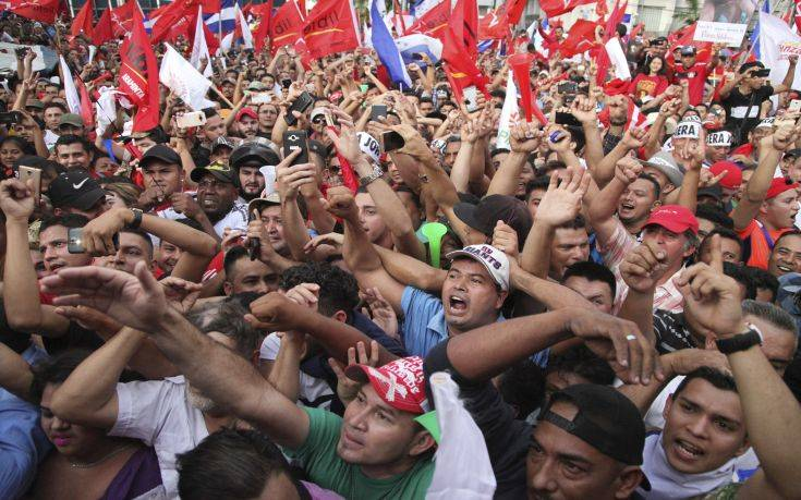 Opposition supporters cheer during a rally where Salvador Nasralla reaffirmed his claim on the presidency of Honduras, in the central park of San Pedro Sula, Honduras, Saturday, Jan. 6, 2018. Following a disputed election marred by irregularities, incumbent Juan Orlando Hernandez was declared the victor and will be inaugurated on Jan. 27. At a march and rally that drew thousands, Nasralla said he would not stop calling for protests and civil disobedience until Hernandez agrees to step down. (AP Photo/Fernando Antonio)