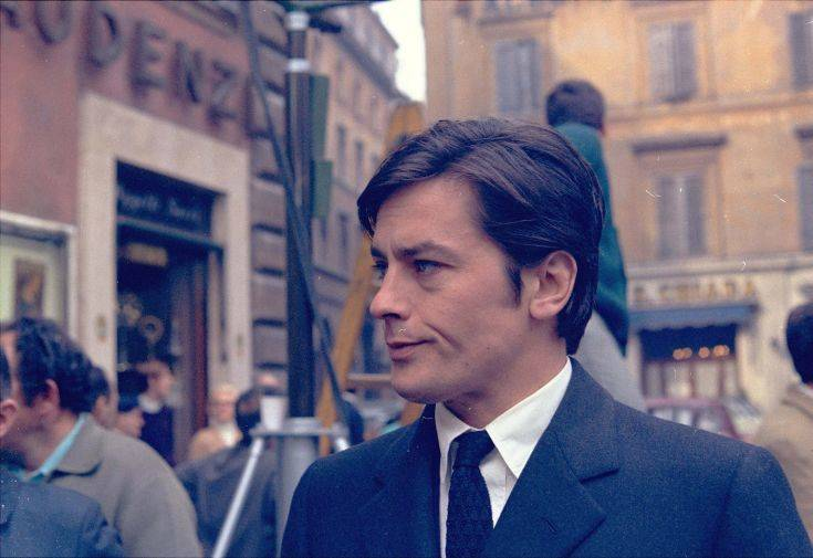 "French actor Alain Delon takes a short walk off the set of a new film, ""The Sicilians,"" during a break in the shooting in the center of Rome March 27, 1969. (AP Photo/Jim Pringle)"