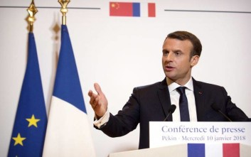 French President Emmanuel Macron speaks at a press conference at the French Embassy in Beijing, Wednesday, Jan. 10, 2018. (AP Photo/Mark Schiefelbein, Pool)