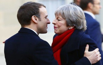 British Prime Minister Theresa May is welcomed by French President Emmanuel Macron before a lunch at the Elysee Palace in Paris, Tuesday, Dec. 12, 2017. More than 50 world leaders are gathering in Paris for a summit that Macron hopes will give new momentum to the fight against global warming, despite U.S. President Donald Trump's rejection of the Paris climate accord. (AP Photo/Francois Mori)