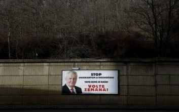 "In this picture taken on Wednesday Jan. 24, 2018, a poster promotes presidential candidate Milos Zeman prior the second round of the presidential elections in Prague, Czech Republic. The former head of the Academy of Sciences Jiri Drahos faces the pro-Russian incumbent Milos Zeman in a tight Czech presidential runoff vote Jan. 26-27, 2018. The poster reads ""Stop migrants and Drahos. This is our Land! Vote Zeman!"" (AP Photo/Petr David Josek)"