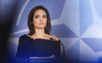 The Special Envoy for the United Nations High Commissioner for Refugees Angelina Jolie addresses the media after a meeting at NATO headquarters in Brussels on Wednesday, Jan. 31, 2018. (AP Photo/Geert Vanden Wijngaert)