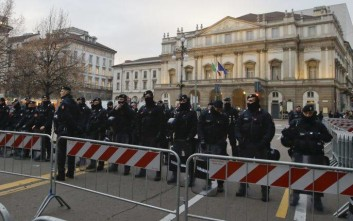 "Carabinieri (Italian paramilitary Police) officers patrol the area in front of La Scala opera house, prior to the gala season opener, Umberto Giordano's opera ""Andrea Chernier"", in Milan, Italy, Thursday, Dec. 7, 2017. La Scala season-opener Thursday, held each year on the Milan feast day St. Ambrose, is considered one of the highlights of the European cultural calendar. (AP Photo/Luca Bruno)"