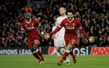 FILE - In this Dec. 6, 2017 file photo, Liverpool's Mohamed Salah, right, celebrates after scoring his side's seventh goal during the Champions League Group E soccer match in Liverpool, England. Salah, one of the hottest soccer players in the world right now, was once rejected by his local team. That he succeeded anyway is being latched onto by fellow Egyptians as a sign of hope for a country for years mired bypolitical instability and violence, deadly terrorist attacks and an economic crisis. (AP Photo/Rui Vieira, File)