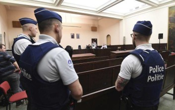 Police officers guard the courtroom during the trial of Salah Abdeslam at the Brussels Justice Palace in Brussels on Monday, Feb. 5, 2018. Salah Abdeslam and Soufiane Ayari face trial for taking part in a shooting incident in Vorst, Belgium on March 15, 2016. The incident took place when six members of a Franco-Belgian research team investigating the attacks in Paris were conducting a search in an allegedly empty safe house of the terrorists and were attacked. (Emmanuel Dunand, Pool Photo via AP)