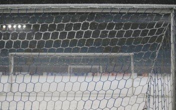 Snow covers a goal net on a pitch at the Arena Khimki stadium ahead of the Champions League Group D soccer match on Wednesday between CSKA Moscow and Bayern Munich, in Moscow, Tuesday, Nov. 26, 2013. (AP Photo/Pavel Golovkin)